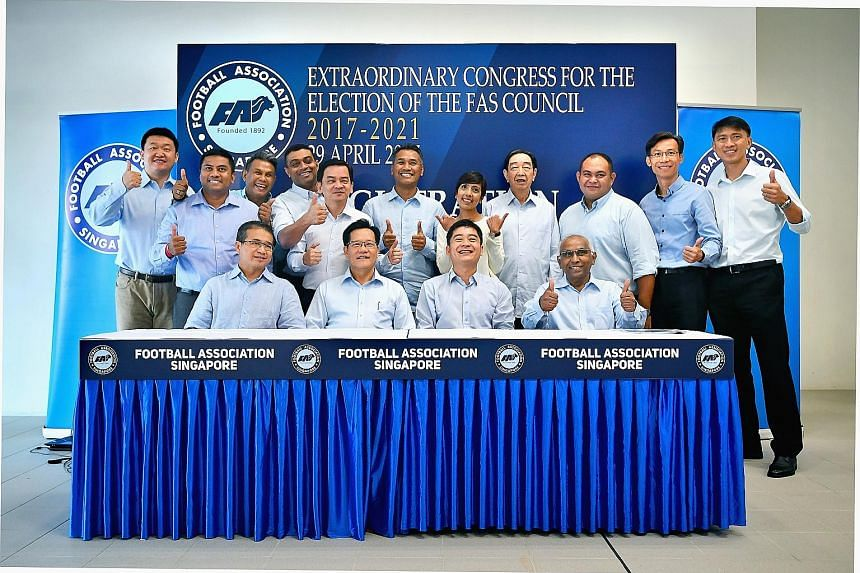 Team LKT in high spirits after their victory in the FAS election was announced yesterday. Top row (from left): Mr Forrest Li, Mr Rizal Rasudin, Mr Yakob Hashim, Dr Dinesh Nair, Mr Kelvin Teo, vice-president Razali Saad, Ms Sharda Parvin, vice-preside