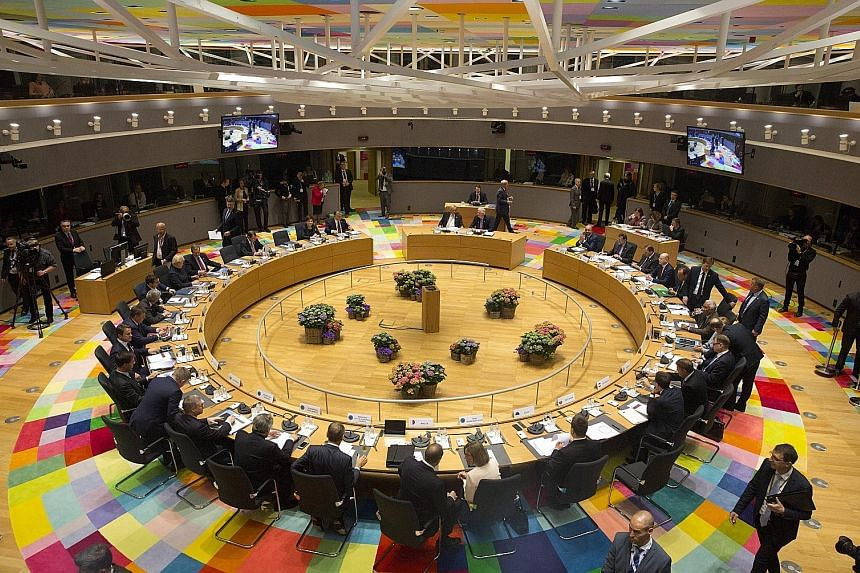 Leaders of the 27 remaining European Union countries met at a special summit in Brussels yesterday and adopted a set of divorce terms for Britain which had been hammered out by their diplomats over the past month.