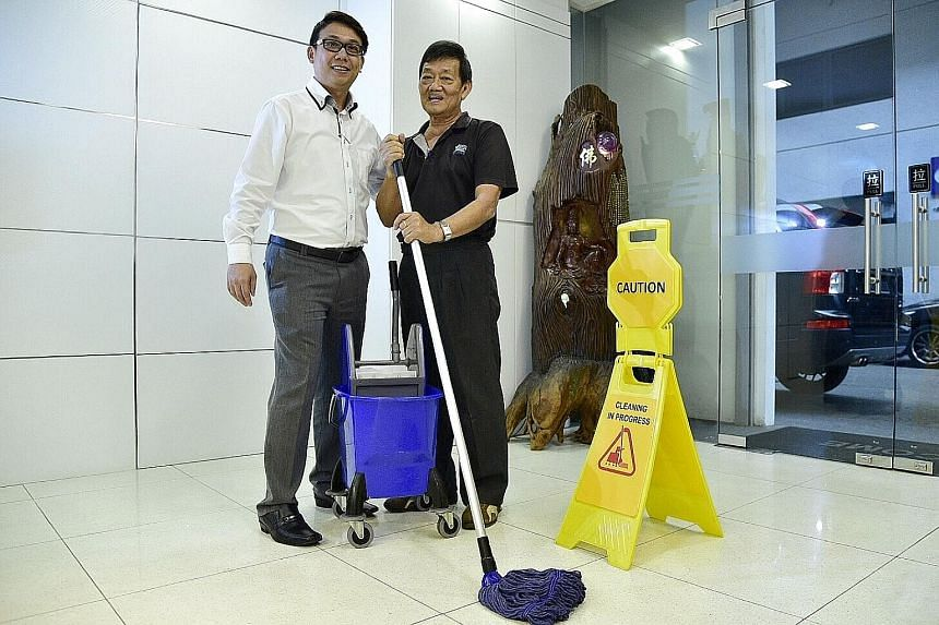 Mr Thomas Ang, 36 , head of operations at Weishen Industrial Services, with Mr Dicky Ong, 60, cleaning services supervisor, at their company's Bukit Batok headquarters.