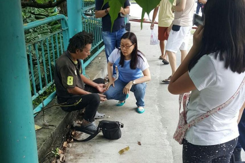 A man believed to be the taxi driver speaking to a passer-by, after a Trans-Cab taxi exploded along Commonwealth Avenue, on April 30, 2017.