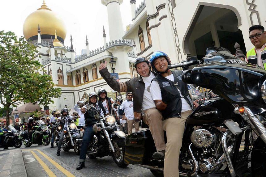 Parliamentary Secretary for Home Affairs Amrin Amin arriving at Sultan Mosque in a convoy of bikers as part of the launch for the Dadah itu Haram anti-drug campaign, on April 30, 2017.