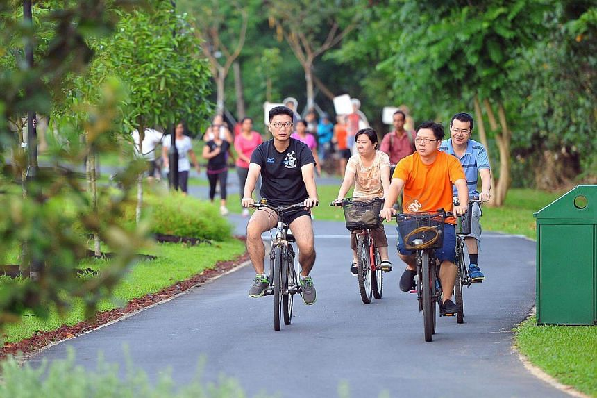 People cycling on the newly completed route at the Ang Mo Kio Walking and Cycling Town.