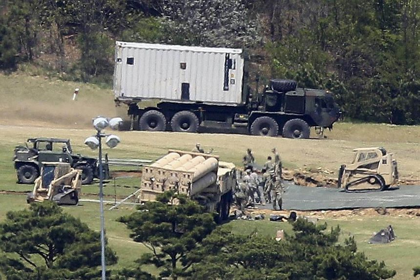 An advanced US missile defense system, dubbed the Terminal High Altitude Area Defense (THAAD), is deployed in a golf course in Seongju, South Korea, on April 27, 2017.