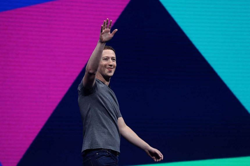 Facebook CEO Mark Zuckerberg waving to the audience at Facebook's F8 Developer Conference on April 18, 2017.