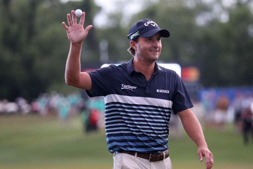 Kevin Kisner waving to the crowd after making an eagle putt on the 18th hole during the final round of the Zurich Classic on April 30, 2017.
