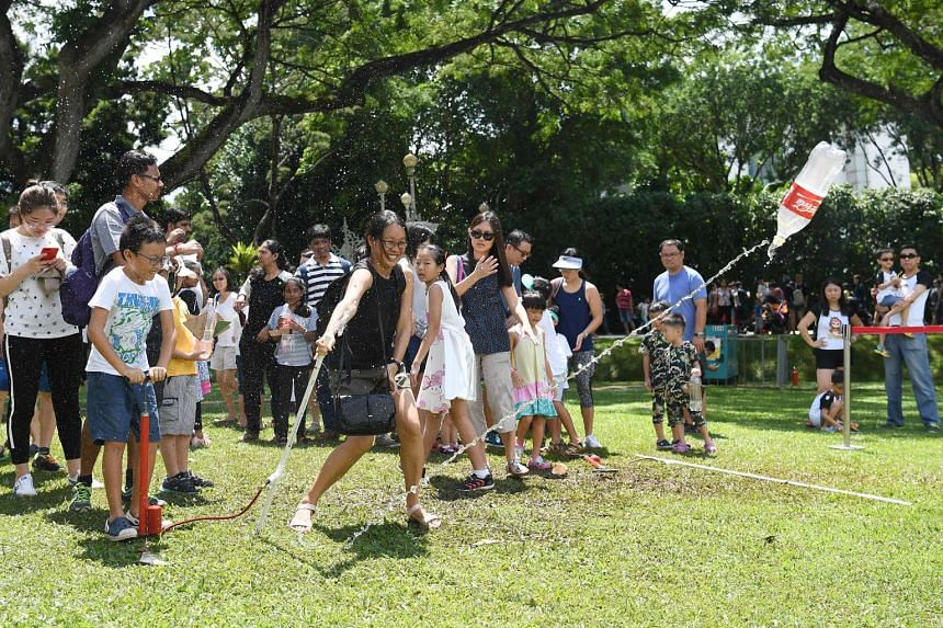 People playing games at the Istana during the open house on May 1, 2017.