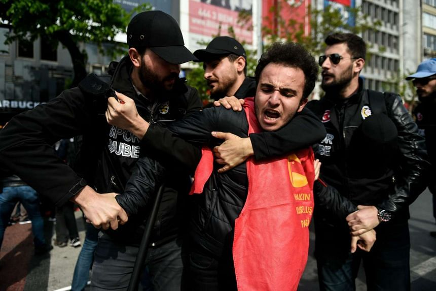 Turkish riot police arrest a protester at the May Day march.