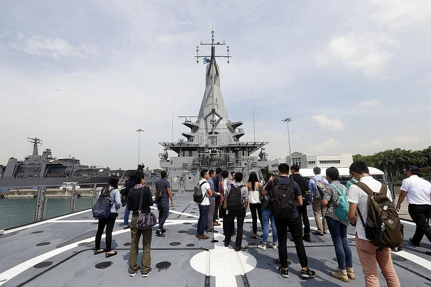 Members of the media on a tour last week of LMV Independence, the first of eight Littoral Mission Vessels designed and built here. Prime Minister Lee Hsien Loong will commission the vessel on Friday, marking 50 years since the Singapore naval ensign