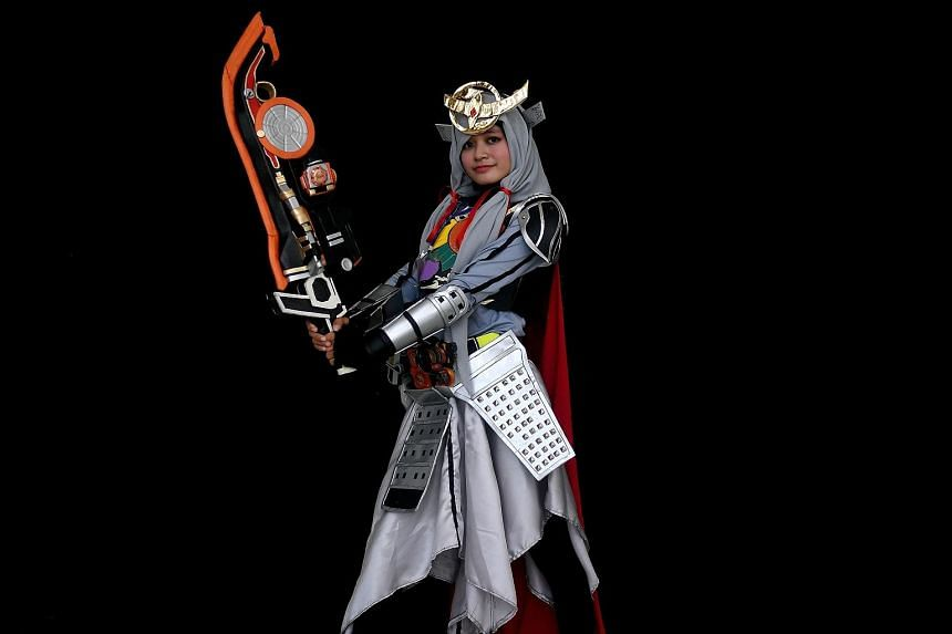 Ange, a young Indonesian Muslim cosplayer, is dressed as the Kamen rider Gaim.