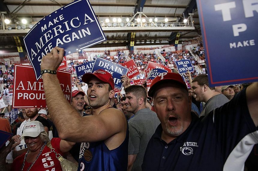 Supporters in Harrisburg, Pennsylvania, where US President Donald Trump held a rally on Saturday. He said under his administration, more than 600,000 new jobs had been created and illegal immigration across the country's southern border has been redu