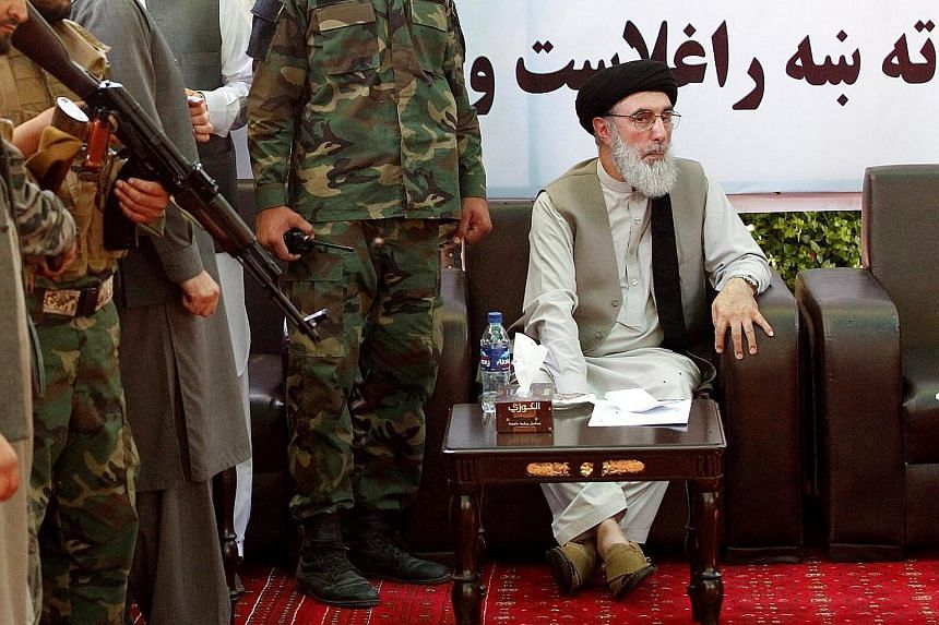 Warlord Gulbuddin Hekmatyar speaking to supporters in Laghman province, Afghanistan, on Saturday. He was allowed to enter the country after the United Nations and the Obama administration lifted anti-terror bans on him.