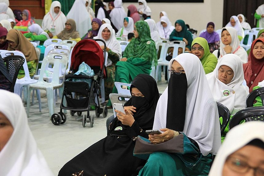 Women attending the annual PAS congress in Alor Setar last week could be spotted wearing face veils in addition to the now standard headscarves. Despite rising conservatism among Muslims in Malaysia, it is still unusual to see women in niqab on the s