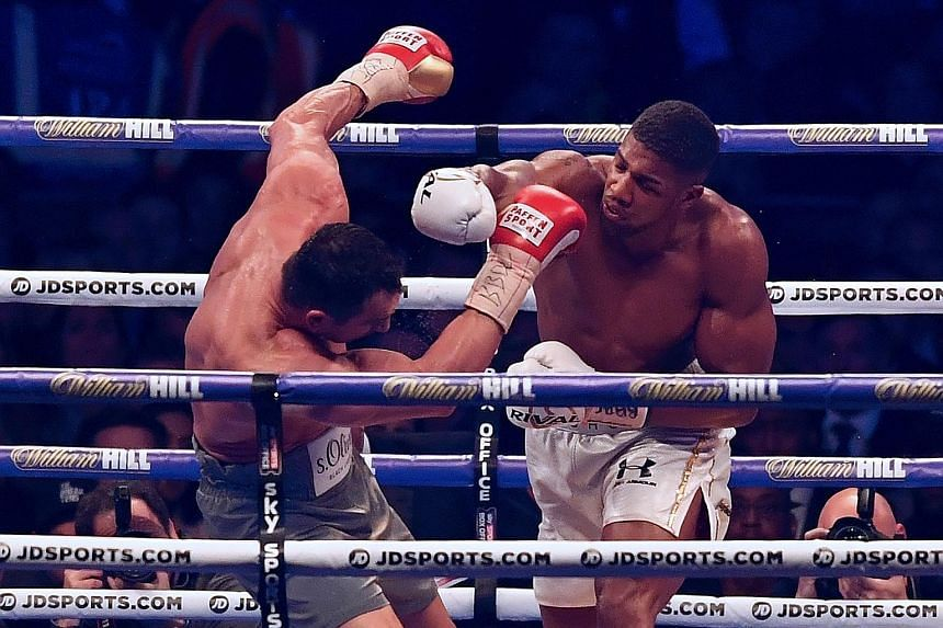 Britain's Anthony Joshua (right) connecting on a right-hand punch in his world heavyweight title fight against Wladimir Klitschko. Despite being knocked down for the first time in his professional career, Joshua managed to recover and win the bout in
