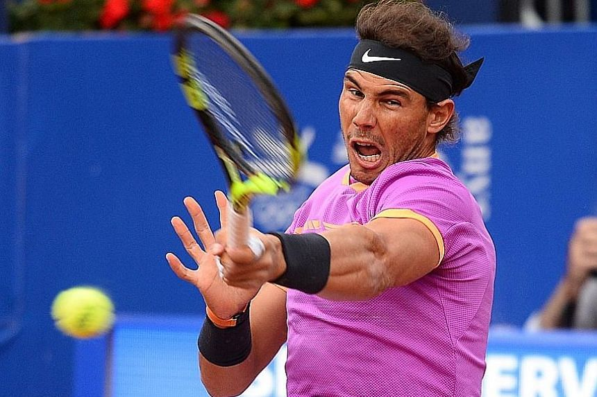 Rafael Nadal whipping a forehand against Austria's Dominic Thiem en route to his 10th Barcelona Open title. The Spaniard won 6-4, 6-1 yesterday, a week after lifting an Open era-record 10th crown at the Monte Carlo Masters. The 14-time Grand Slam cha