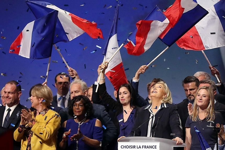 Ms Marine Le Pen being applauded by supporters after her rally on Friday in Nice, the location of a terror attack last year.
