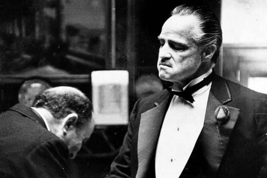 Cinema still of The Godfather starring Marlon Brando (right) as the ageing godfather.