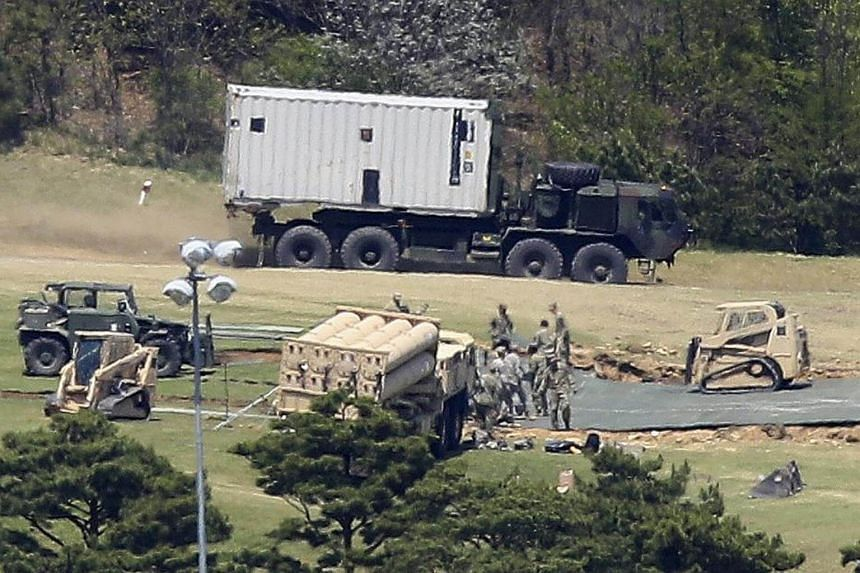 An advanced US missile defense system, dubbed the Terminal High Altitude Area Defense (THAAD), is deployed in a golf course in the country's southeastern county of Seongju, South Korea, on April 27, 2017.