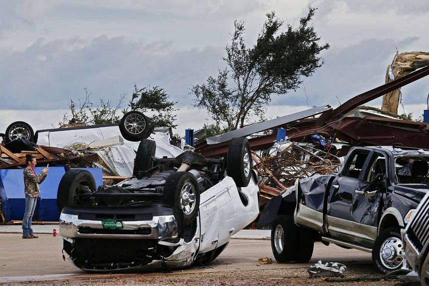 This is not a scene from The Fate of the Furious but at a car dealership destroyed by tornado near Canton, Texas, on April 30, 2017.