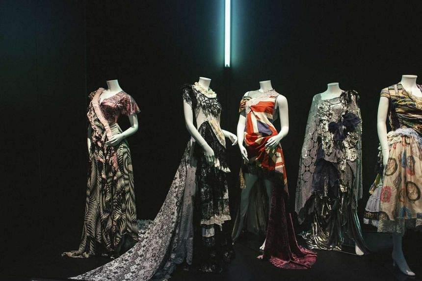Dresses on display at the Calais Lace Museum and a designer at the Noyon Dentelle lace factory in Calais. The effect of globalisation on the city's lace  industry is an economic pattern repeated across France and has become one of the most divisive i