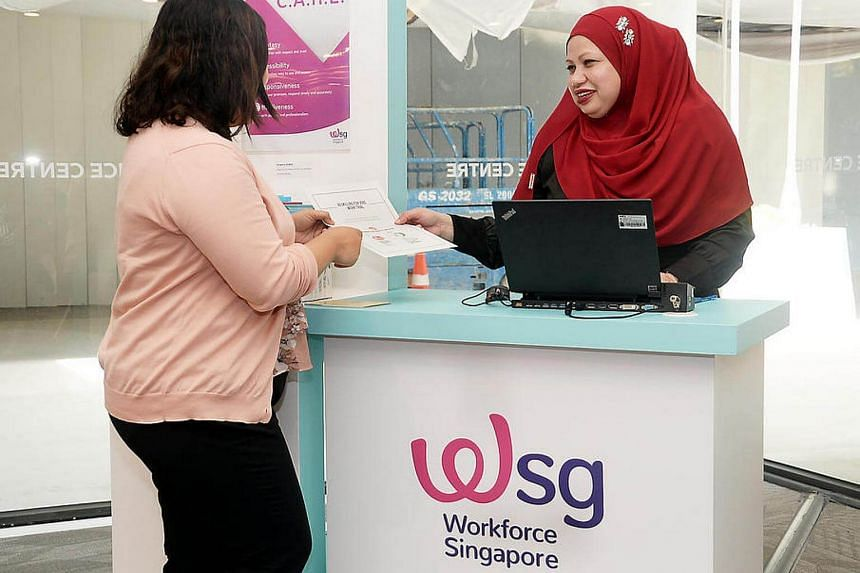 Emilena Abdul Rahman (right), a career coach in Singapore Workforce (WSG), helping her client in taking up the Professional Conversion Programme.