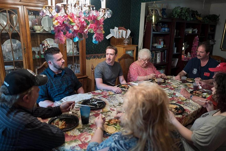 Mark Zuckerberg (centre) had dinner with the Moore family in Newton Falls.