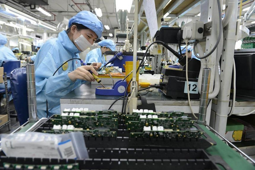 Workers at Add-Plus, an electronics manufacturing company that makes printed circuit boards, in 2013.