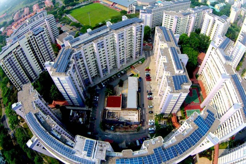 Solar panels on the rooftops of Housing Board blocks in Jurong, which are among more than 800 buildings which local solar provider Sunseap uses to supply clean energy to Apple's Singapore operations.