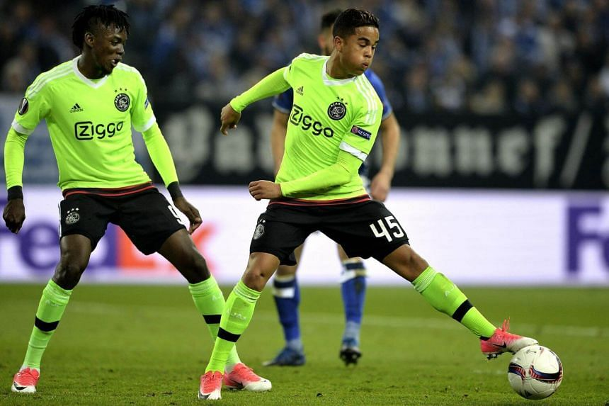Amsterdam's Justin Kluivert (centre) and Bertrand Traore (left) in action during the Uefa Europa League quarter final, second leg soccer match between FC Schalke 04 and Ajax Amsterdam, in Gelsenkirchen, Germany, on April 20, 2017.