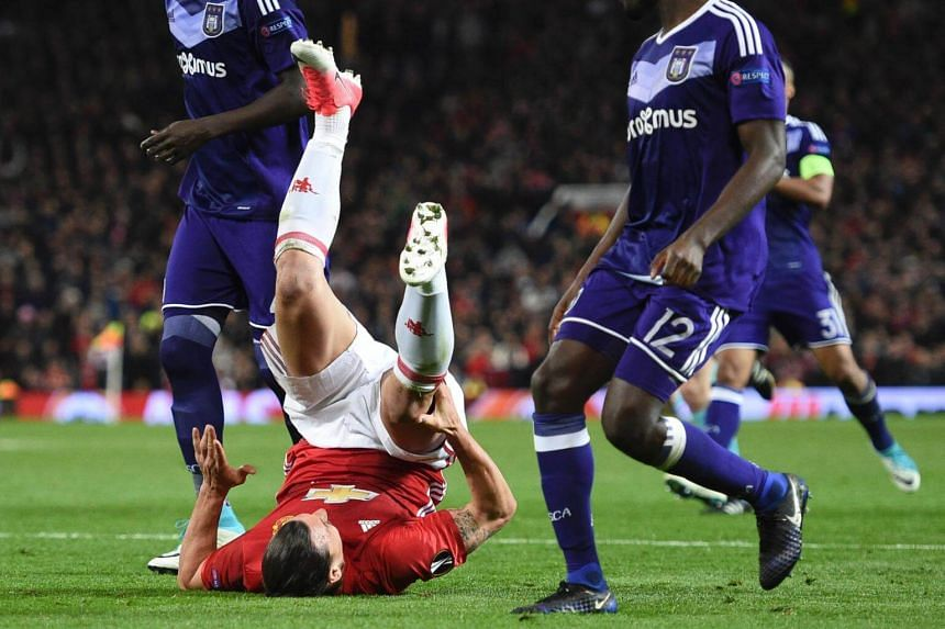 Manchester United's striker Zlatan Ibrahimovic goes down holding his knee during the Uefa Europa League quarter-final second leg football match between Manchester United and Anderlecht at Old Trafford in Manchester, England, on April 20, 2017.
