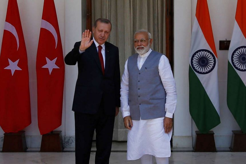 Turkish President Tayyip Erdogan (left) gestures as India's Prime Minister Narendra Modi looks on during a photo opportunity ahead of their meeting at Hyderabad House in New Delhi, India on May 1, 2017.