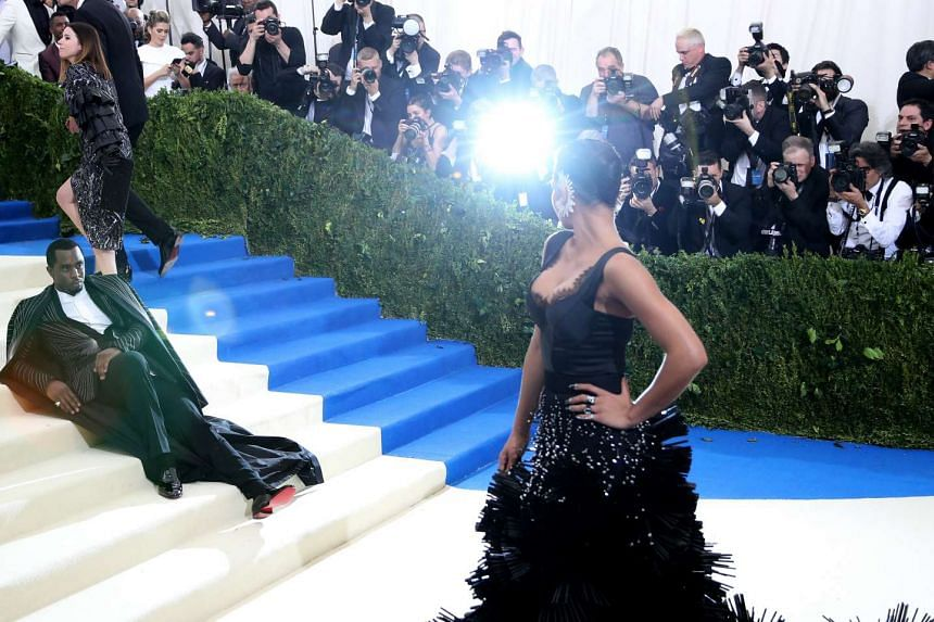 Sean 'Diddy' Combs (left) and Cassie arrive on the red carpet the 2017 Metropolitan Museum of Art's Costume Institute ball.