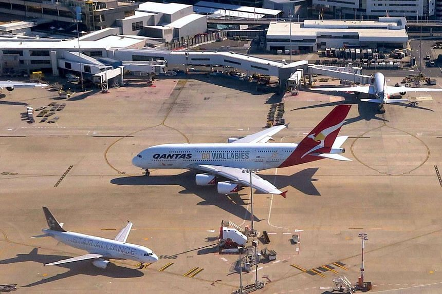 A Qantas Airlines Airbus A380 moves along the tarmac towards the terminal at Sydney's International Airport.