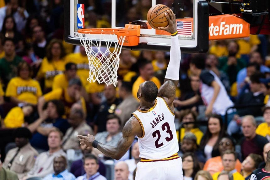 Cleveland Cavaliers forward LeBron James dunking the ball against the Toronto Raptors during their NBA playoff game on May 1, 2017.