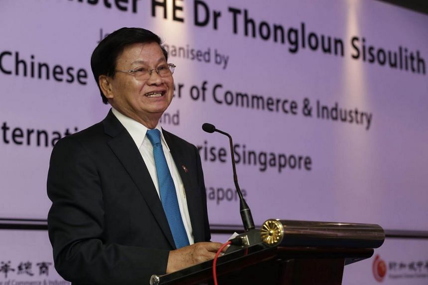 Laos Prime Minister Thongloun Sisoulith speaking during a business forum organised by Singapore Chinese Chamber of Commerce and Industry and IE Singapore at the Singapore Flyer on May 2, 2017.