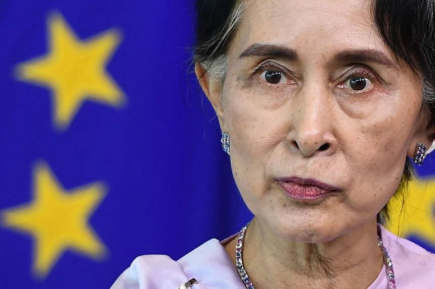 Aung San Suu Kyi addresses a press conference after her meeting with the EU's Federica Mogherini.