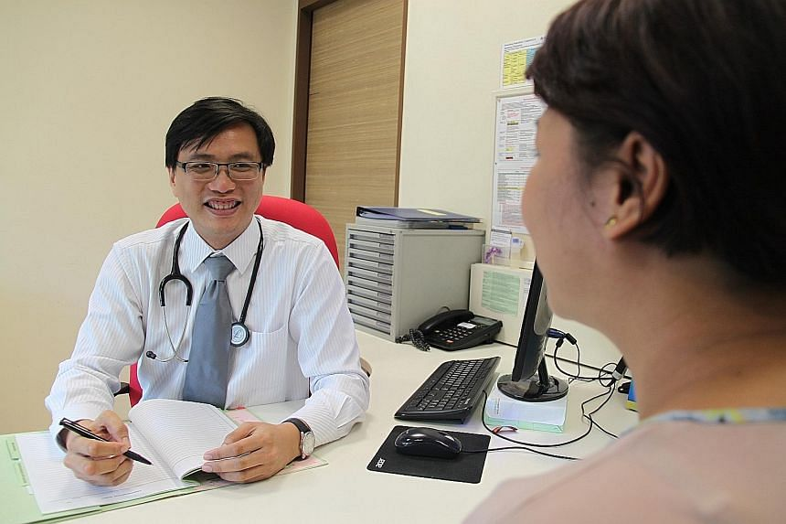 Dr Wei Ker-Chiah, chief of IMH's department of community psychiatry, treating a patient at Queenstown Polyclinic.