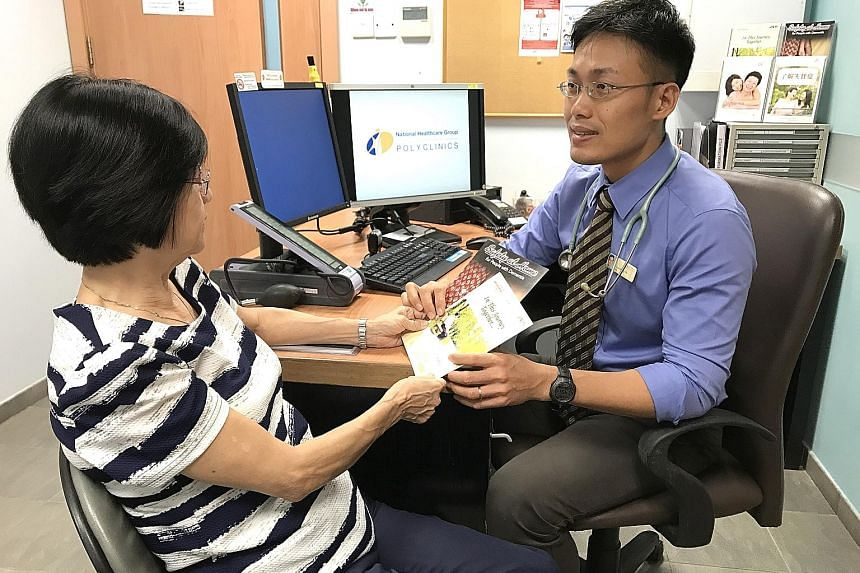 Dr Low Kang Yih, a family physician, with a patient at the Dementia Care Clinic at Ang Mo Kio Polyclinic.