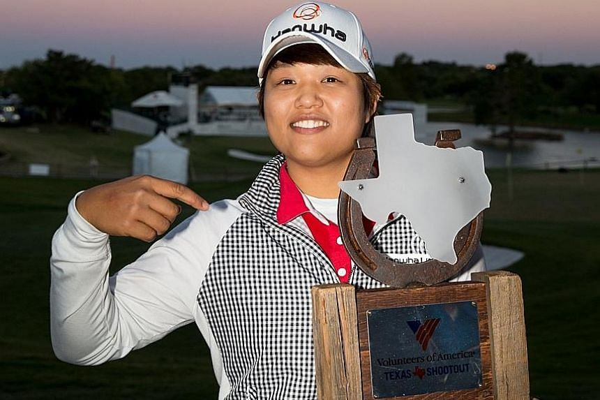 Haru Nomura of Japan with her trophy after defeating Cristie Kerr on the sixth play-off hole to clinch the Volunteers of America Texas Shootout. She had led by two strokes on Saturday, but shot a five-over 76 on Sunday to tie with Kerr on 281 at the