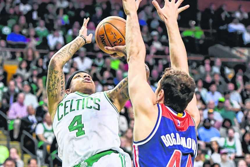 Isaiah Thomas, who had a game-high 33 points for Boston, shooting against Washington guard Bojan Bogdanovic. The Wizards led 16-0 in the first quarter before Boston got on the board with free throws from Thomas, who was pivotal in the 123-111 win.