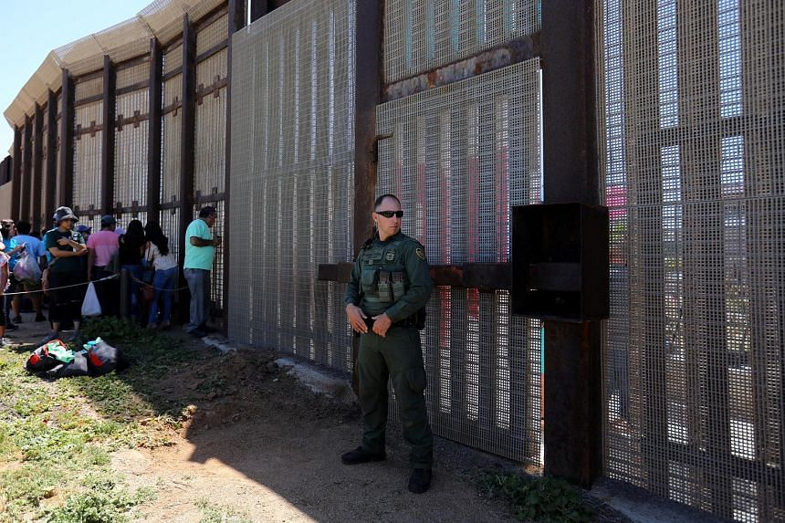 A US border patrol agent stationed along the Mexico border in San Diego last week. The White House sought funding to begin building the border wall, but this was rejected in the bipartisan deal struck by US House and Senate negotiators early yesterda