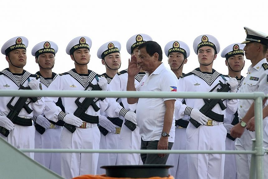 """Philippine President Rodrigo Duterte on one of the three Chinese naval vessels in Davao City yesterday. The visit """"is part of confidence-building and goodwill"""", he said."""