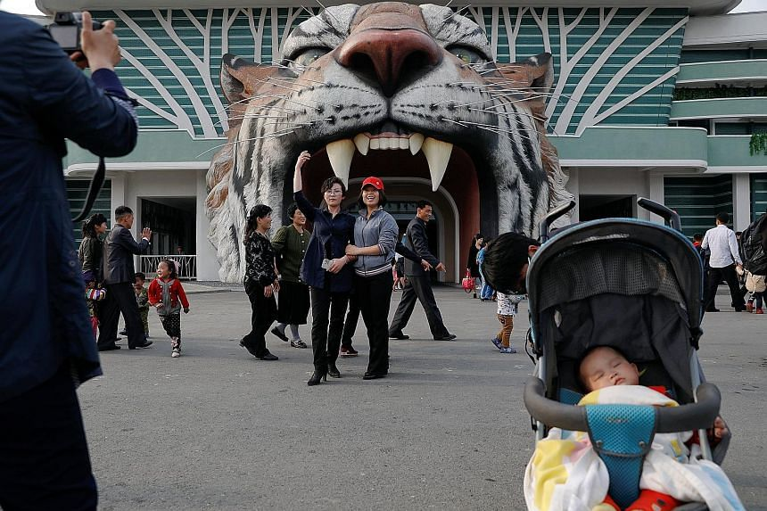 Holiday-making at a zoo in Pyongyang last month. Tensions on the Korean peninsula have been running high for weeks, with signs that Pyongyang might be preparing a long-range missile launch or a sixth nuclear test - and Washington refusing to rule out