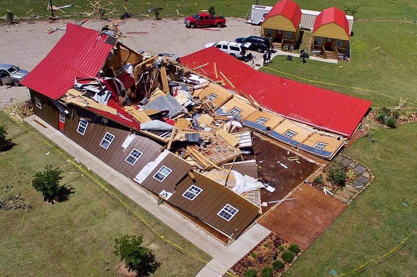 Texas was hit by at least four tornadoes yesterday, leaving behind damaged property and overturned cars, as well as causing at least five fatalities in the state.
