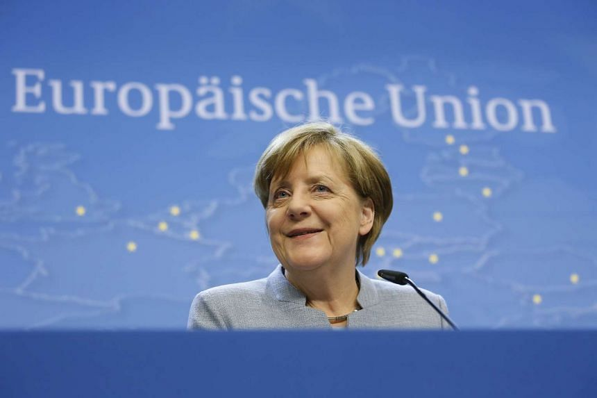 German Chancellor Angela Merkel speaks during a news conference after the special European summit in Brussels.