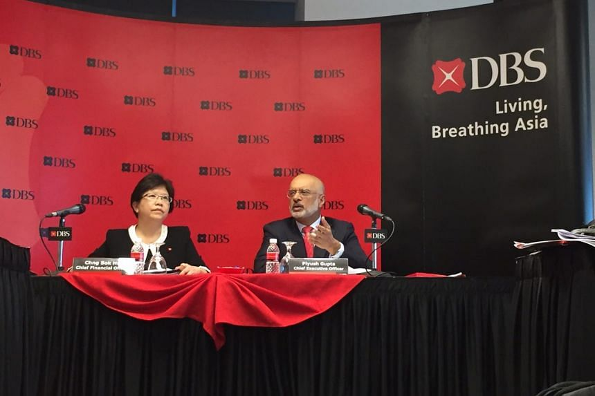 DBS chief financial officer Chng Sok Hui and DBS chief executive officer Piyush Gupta speaking at a media conference  on May 2, 2017.