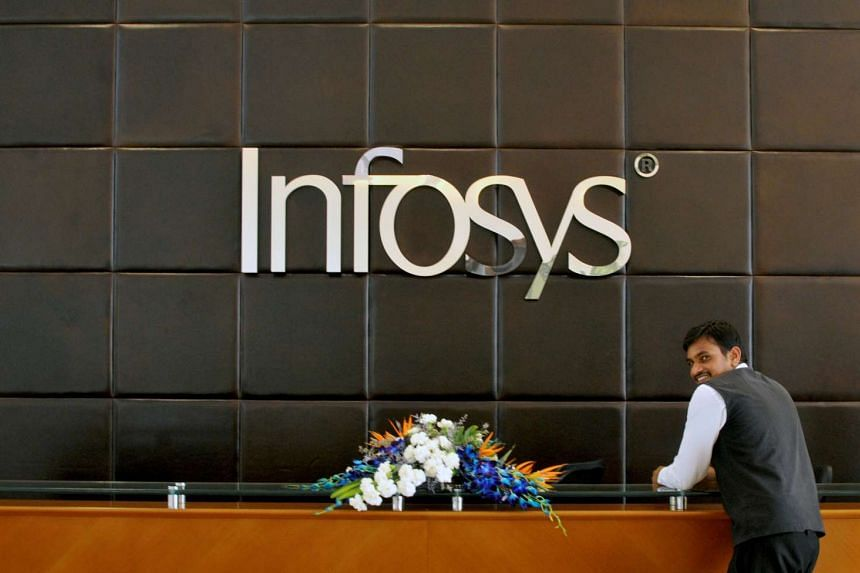 An employee of Infosys standing at the front desk of its headquarters in Bengaluru, India.