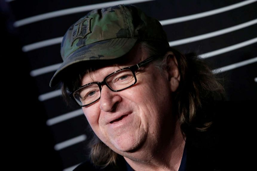 Filmmaker Michael Moore poses as he arrives for the 20th Annual Webby Awards in Manhattan.