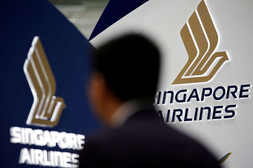A man walks past a Singapore Airlines signage at Changi Airport.