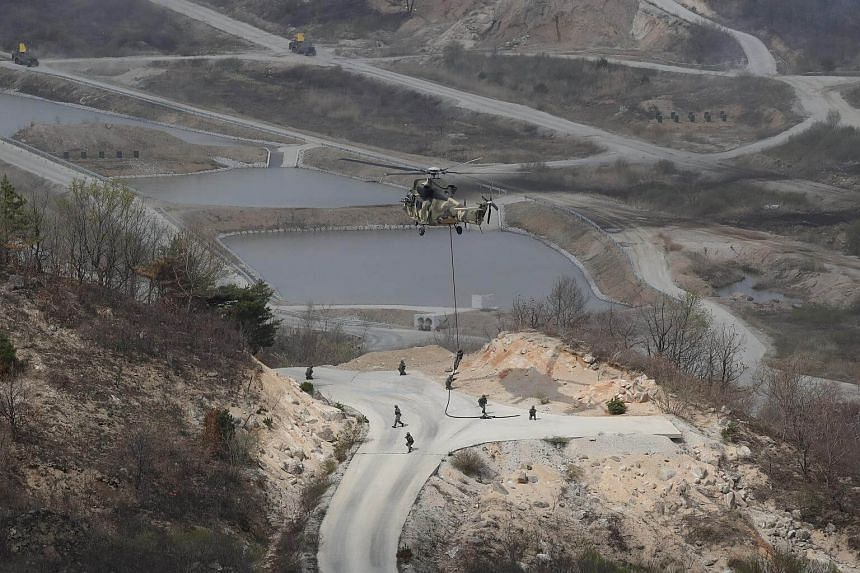 South Korean soldiers and a Surion Helicopter take part in the joint South Korea/USA integrated live fire exercise, on April 21, 2017.