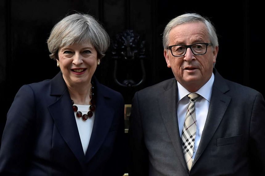 Britain's PM Theresa May welcoming European Commission President Jean-Claude Juncker to Downing Street in London on April 26, 2017.